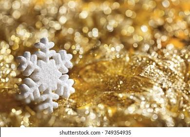 Snowflake Golden Background, Sparkling Snow Flakes Decoration over De Focused Lights