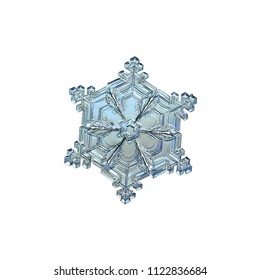 Snowflake isolated on white background. Macro photo of real snow crystal: beautiful star plate with fine hexagonal symmetry, six short, broad arms and glossy relief surface.