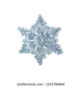 Snowflake isolated on white background. Macro photo of real snow crystal: elegant star plate with fine hexagonal symmetry, six short, broad arms and glossy, relief surface with complex inner pattern.