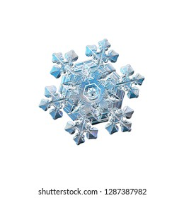 Snowflake isolated on white background. Macro photo of real snow crystal: complex star plate with fine hexagonal symmetry, glossy relief surface, six short, ornate arms and elegant inner details.