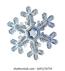 Snowflake isolated on white background. Macro photo of real snow crystal: elegant star plate with hexagonal symmetry, glossy relief surface, massive central hexagon and short, ornate arms.