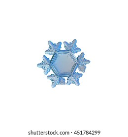 Snowflake isolated on white background. This is macro photo of real snow crystal (3 millimeters from tip to tip) with big and empty central hexagon, relief rim and six symmetrical arms with ridges.