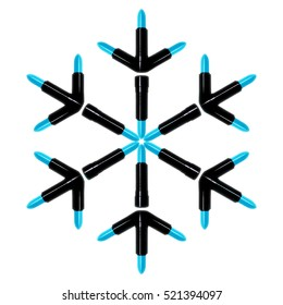 A snowflake made from blue lipsticks representing the upcoming winter holiday season and Christmas. The blue snowflake lipsticks are on an isolated white background with clipping path.