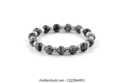 Snowflake obsidian beaded bracelet isolated on white bakground