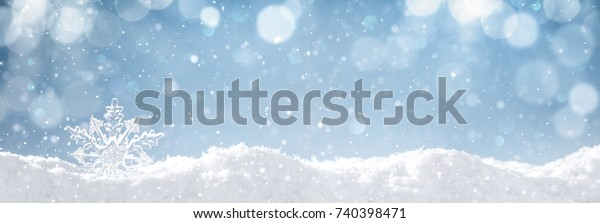 Snowflake on snow.Winter holidays background.