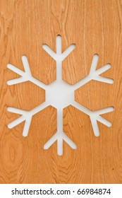 Snowflake sign on wooden surface