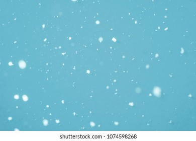 Snowflakes falling in mid air - selective focus