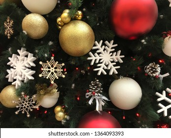 Snowflakes golden Christmas balls on the Christmas tree New Year object winter traditional background