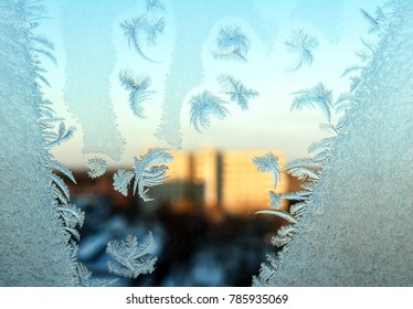 Snowflakes ice pattern on winter window glass