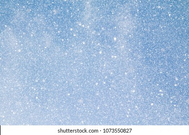 snowflakes on blue sky background