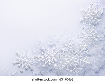 Snowflakes on snow background. Space for text.
