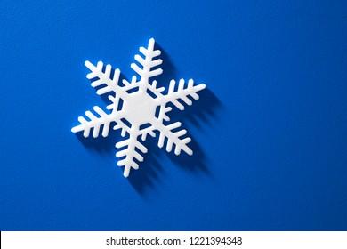 snowfrake on blue background