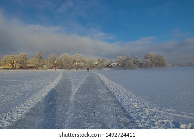 Snow,ice, haze, people tractor over on frozen lake in Sigtuna Sweden