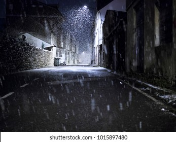 Snowing in the city at night