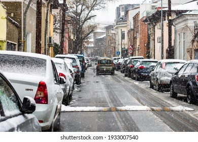 Snowing on cars in the morning, snow on street in Bucharest, Romania, 2021
