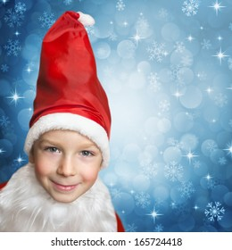 snowing on child in santa clothes