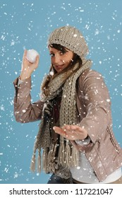 snowing on a  woman throwing a snow ball