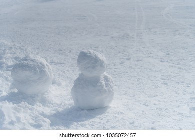 Snowman building on snow field
