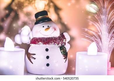 Snowman and candle electric decor for merry christmas on white background. Decoration gift for Merry Christmas and happy new year