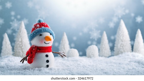 Snowman and Christmas decorations in the snowy day.