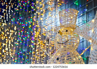 Snowman in colorful lights