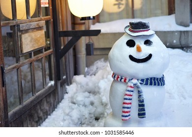 The snowman decorated by scarf and hat is set up in front of the shop at Sakaimachi street in Otaru, Hokkaido, Japan on 13 February 2018