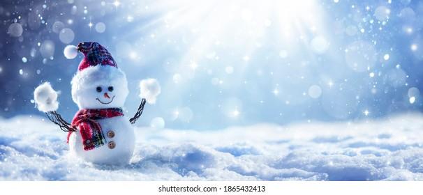 Snowman In Defocused Wintry Landscape