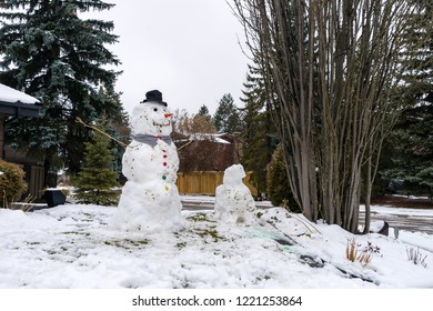 Snowman designed by children play from wet snow after  snowfall