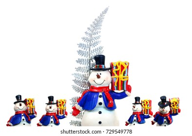 the snowman and gift box with silver tree on white background isolated