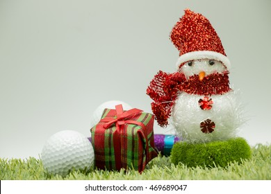 Snowman with golf ball and present