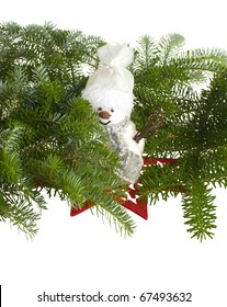 Snowman on red star and pine branches - all isolated over white background