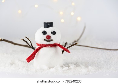Snowman with a red scarf and black hat