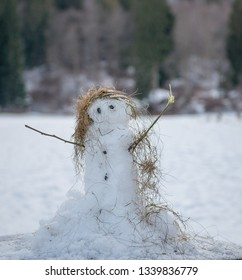 snowman with scarf made of hay