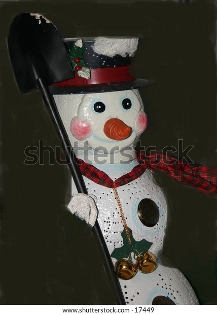 snowman with shovel waiting for it to snow