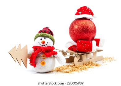 Snowman with sled, Christmas tree and New Year's ball isolated on a white background.