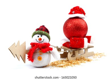 Snowman with sledge, Christmas tree, red ball and Santa Claus hat isolated on white background. Christmas theme.