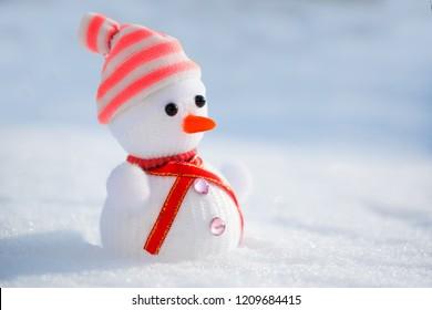 Snowman in the snow. Winter time scene.