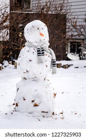 Snowman or snowwoman made by children from wet snow