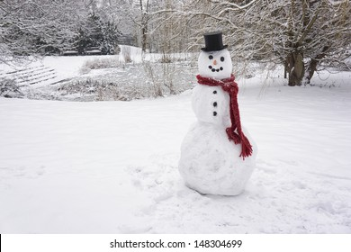 Snowman standing in winter landscape