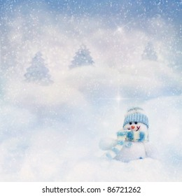 Snowman toy on the bokeh winter background