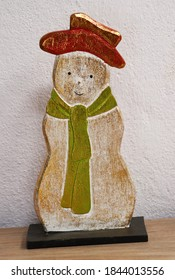 snowman wearing red cap and green scarf