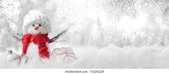 Snowman in winter setting,Christmas background.