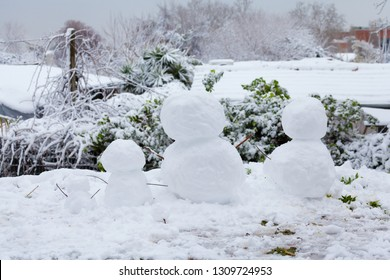 Snowmen family in Rome after a long snowfall