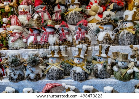 snowmen made of wood and bark of trees sold at christmas market in vienna austria