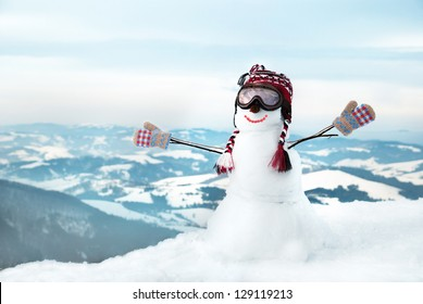 Snowmen at the mountains with mask