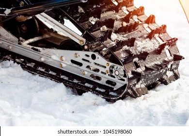 Snowmobile. Close-up of a caterpillar for driving a machine.