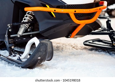 Snowmobile. Close-up ski and shock absorber to slip through snow.