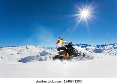 snowmobile excursion in a snowy Alpine valley