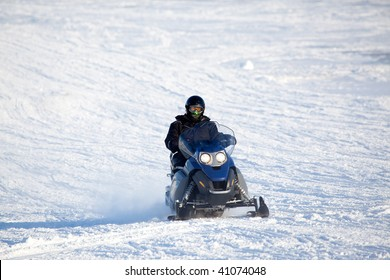 A snowmobile isolated against a winter snow landscape