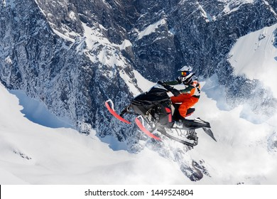 snowmobile jump in the alpine environment